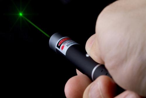 man holding laser pen