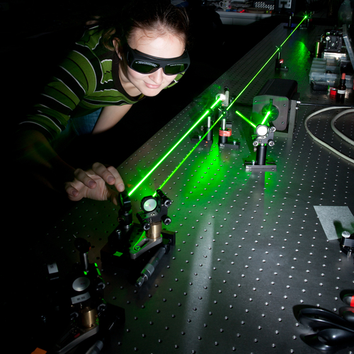 Women with green laser equipment