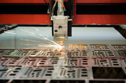 The process of a laser cutting machine cutting through materials
